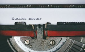 "typerwriter with text, ""stories matter"""